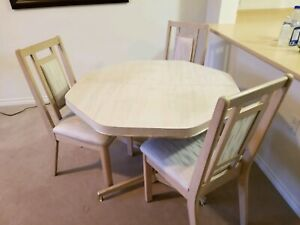 PRICED FOR QUICK SALE!! Table and three chairs