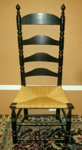 ANTIQUE AMERICAN LADDER BACK CHAIR IN BLACK PAINT W/ RUSH SEAT CIRCA 1750