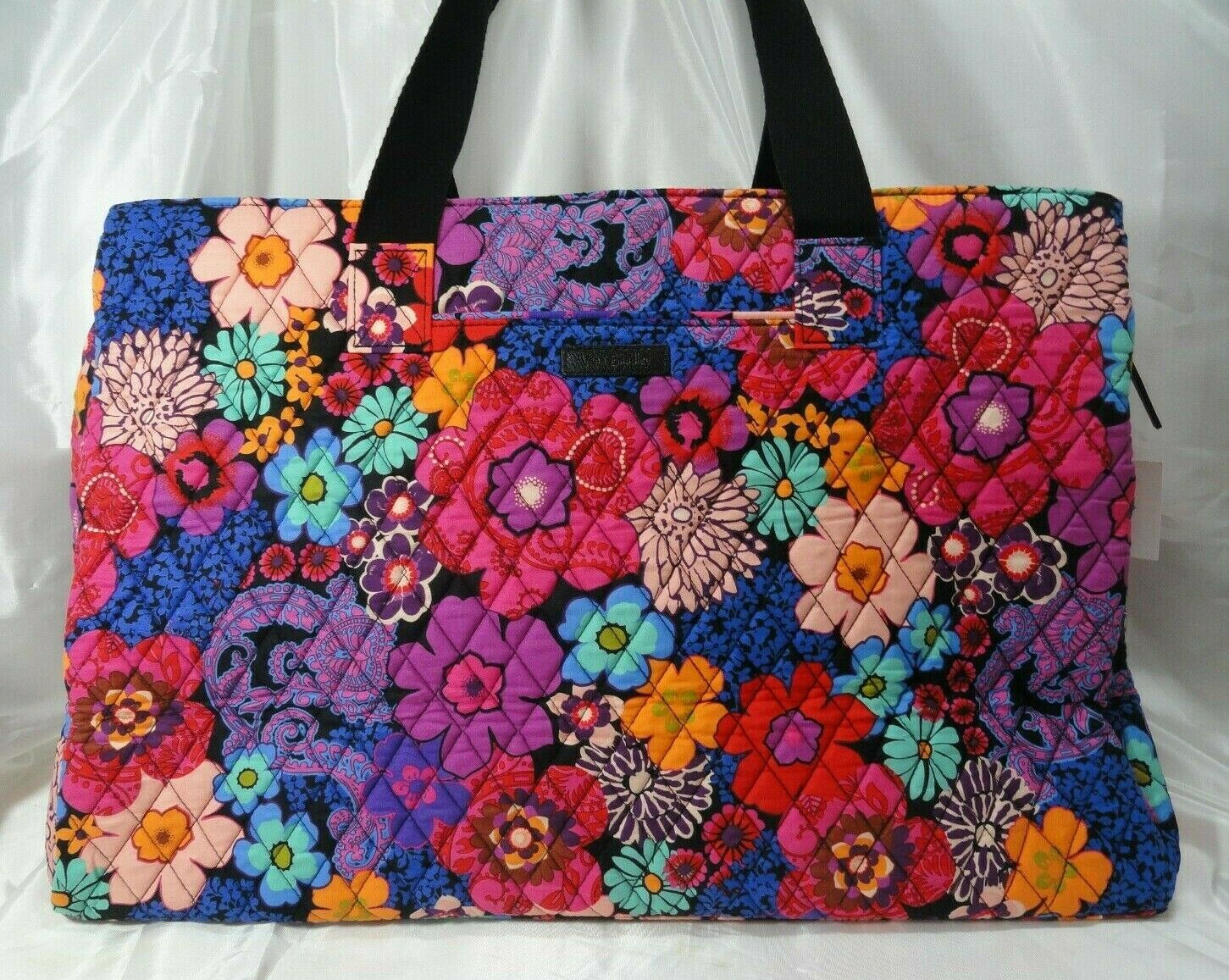 s triple compartment travel bag in floral