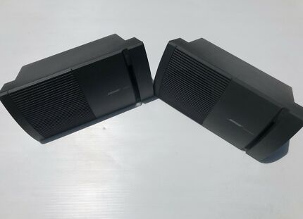 Bose model 100 home audio speakers used in good condition.
