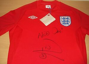RIO-FERDINAND-AUTHENTIC-HAND-SIGNED-AUTOGRAPH-ENGLAND-WORLD-CUP-2010-SHIRT-COA