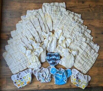 Size Small -18 cloth-eez pre-fold diapers, 5 work horse, 4 covers, 1 Swim diaper Small Cloth Diaper