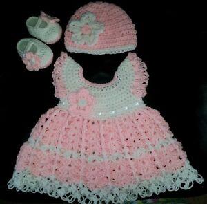 Beautiful white crocheted baby dress