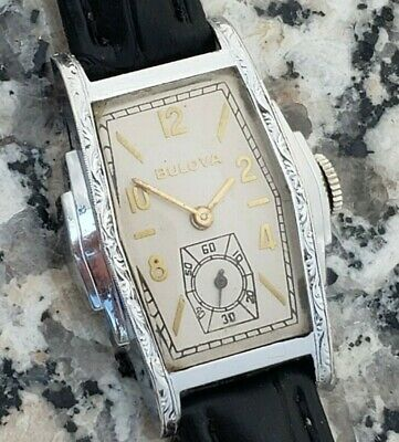 QJ8: CRISP 1932 3-STEPED RARE CHASED ART DECO BULOVA WHITE ROLL GOLD MENS WATCH