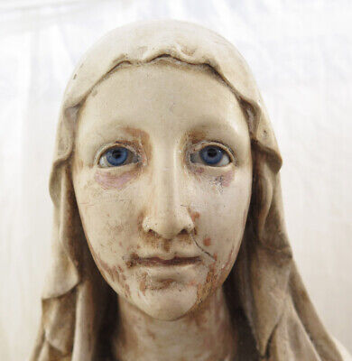 AN ANTIQUE CHALK STRESSED MADONA WITH BLUE GLASS EYES, MISSING HANDS AND DAMAGE