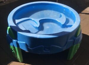 Kids outside water play table