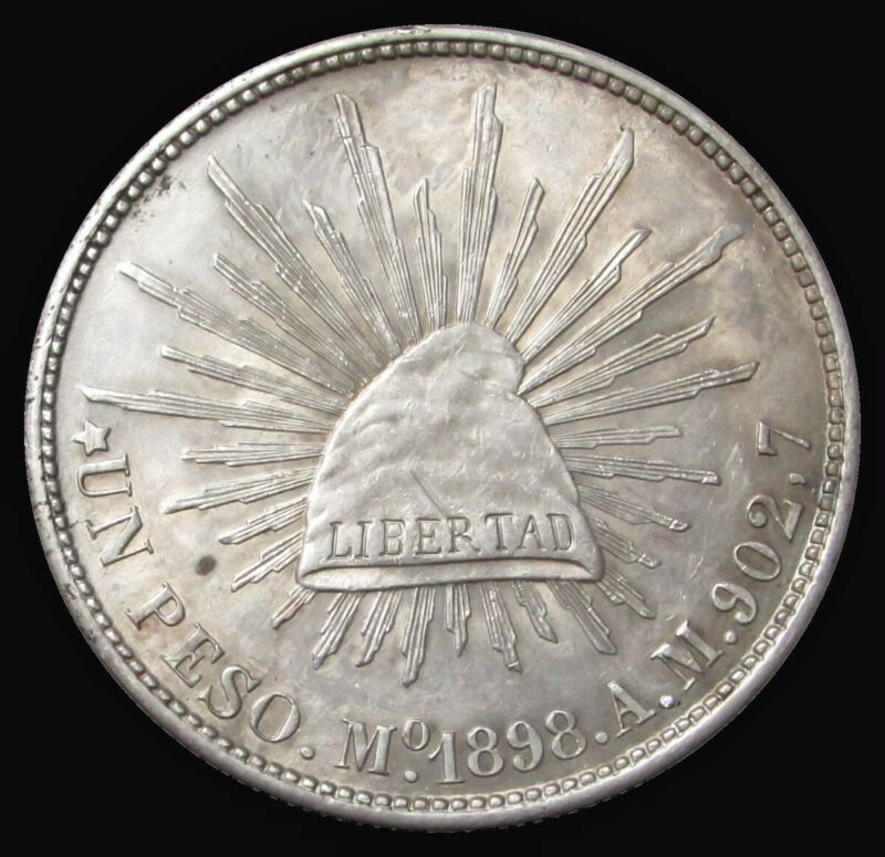 1898 Mo AM SILVER MEXICO PESO CAP & RAYS MEXICO CITY MINT ABOUT UNCIRCULATED
