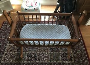 Solid wood bassinet. Comes with mattress and cover.