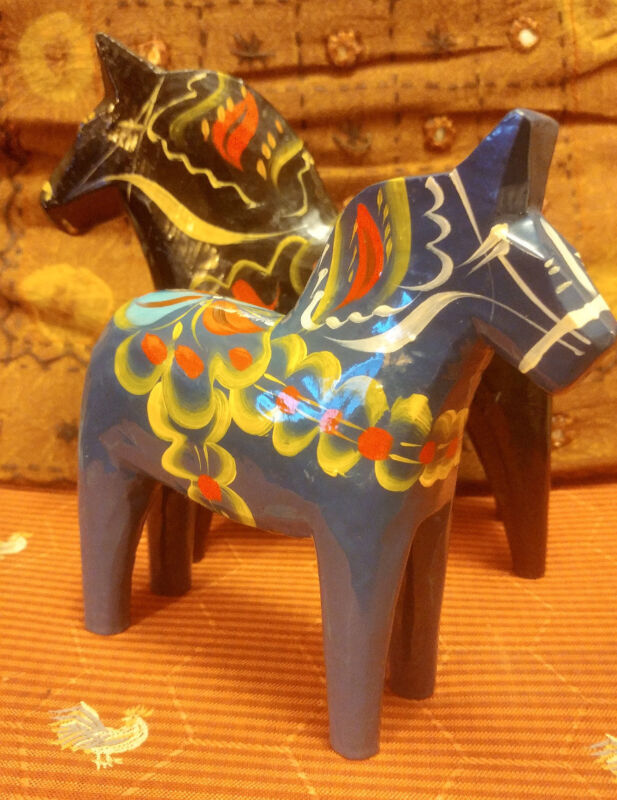 TWO VINTAGE NILS OLSSON SWEDEN HAND PAINTED WOODEN HORSES. BLACK.BLUE