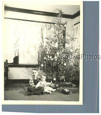 FOUND B&W PHOTO H_8273 LITTLE BOY HOLDS BABY - TRAIN SET UNDER CHRISTMAS TREE