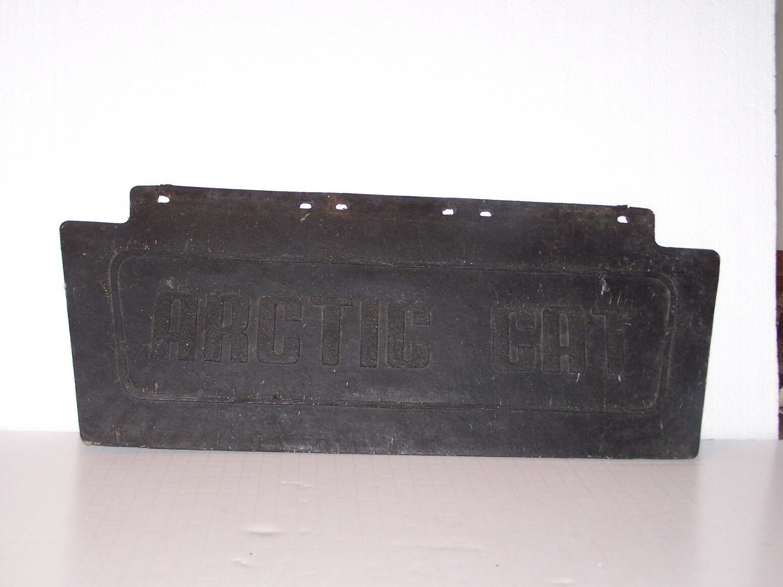 """19"""" X 8"""" X 1/4"""" thick marked Arctic Cat rear mud flap ?? used with some damage"""