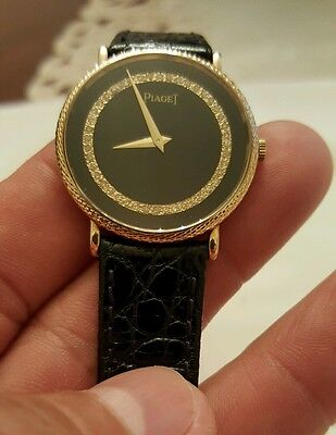 PIAGET 31.5MM. UNISEX 18K SOLID GOLD WATCH WITH BRILL VVS .50CT. DIAMOND  DIAL.