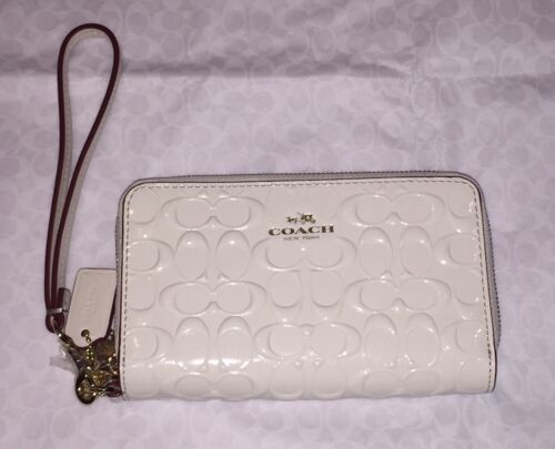 45620ece161a UPC 888067781847 product image for Coach Signature Patent Leather Double  Zip Wristlet wallet Chalk F53310