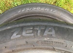 Pair of 225/50/17 tires.