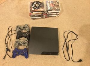 PS3 slim with 4 controllers and 21 games