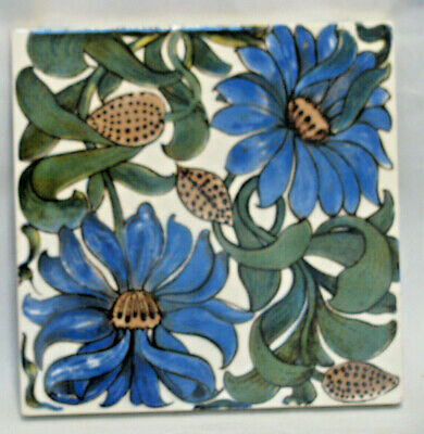 Arts and Crafts style tile with floral design. Decorative Tile Works. V & A