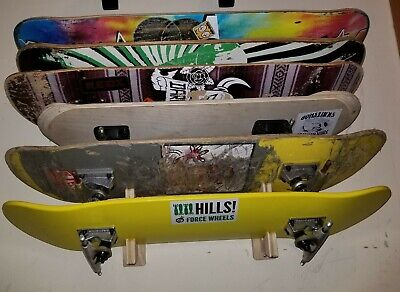 Skateboard deck wall mount display rack holds 8 decks longboard hanger