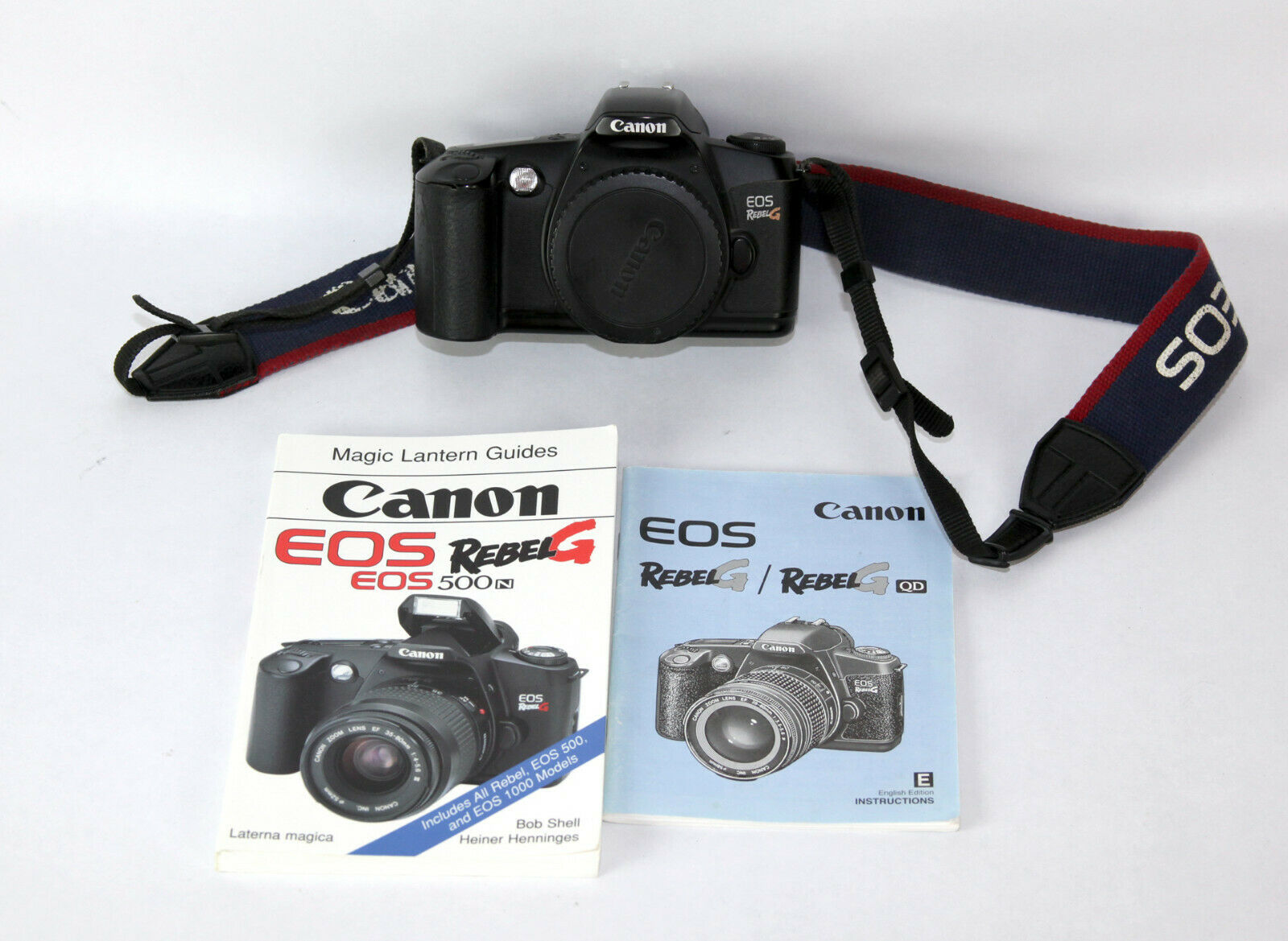 Canon Rebel G 35mm Film AF Camera Body Only, EOS EF Mount W/Strap And Books  - $9.95