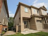 BEAUTIFUL END UNIT FREEHOLD TOWN HOME ON RAVINE LOT!