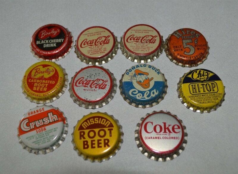 11 different Unused cork backed pop bottle caps