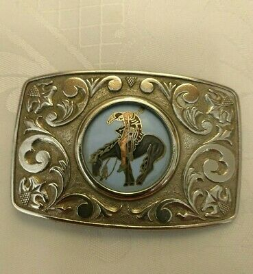 North American white metal belt buckle featuring a North American Indian on...