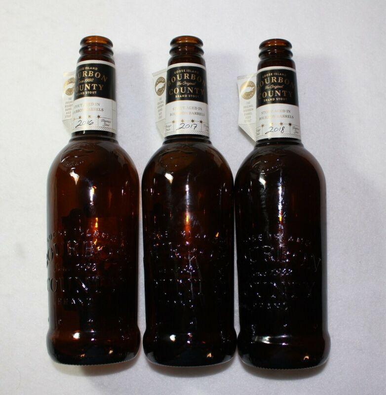 Three Empty Goose Island Bourbon County Stout Bottles 2016 2017 2018 years