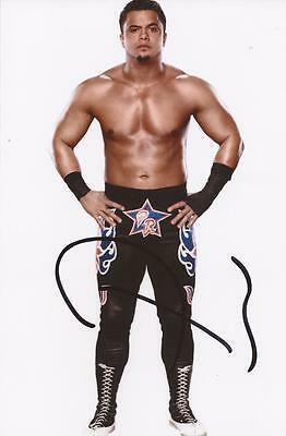 WWE WRESTLING: PRIMO SIGNED 6x4 PORTRAIT PHOTO+COA *THE COLONS*