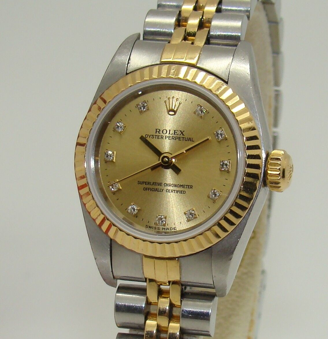 $1900.00 - ROLEX WOMENS OYSTER PERPETUAL SS & 18K CHAMPAGNE DIAMOND DIAL WATCH 67193