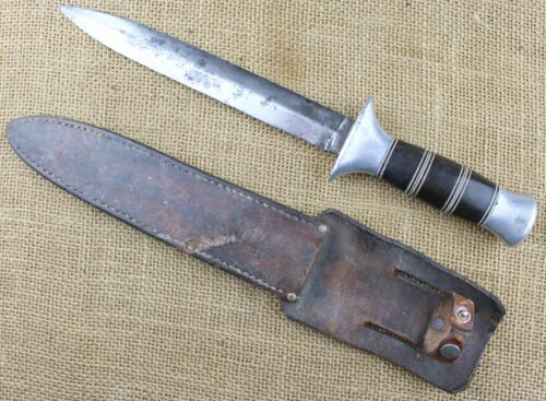 British or US WWII theater made fighting knife? Or could be factory made.