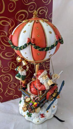 San Francisco Music Box Company Santa In A Hot Air Balloon Plays Up on Housetop