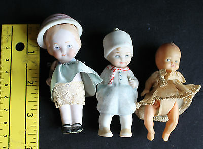 Antique tiny  German bisque and  Italian celluloid dolls