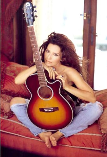 Shania Twain - Sitting Indian Style With A Guitar Between Her Legs !!!!