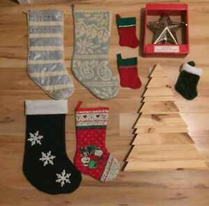 Christmas stockings and wooden tree decoration