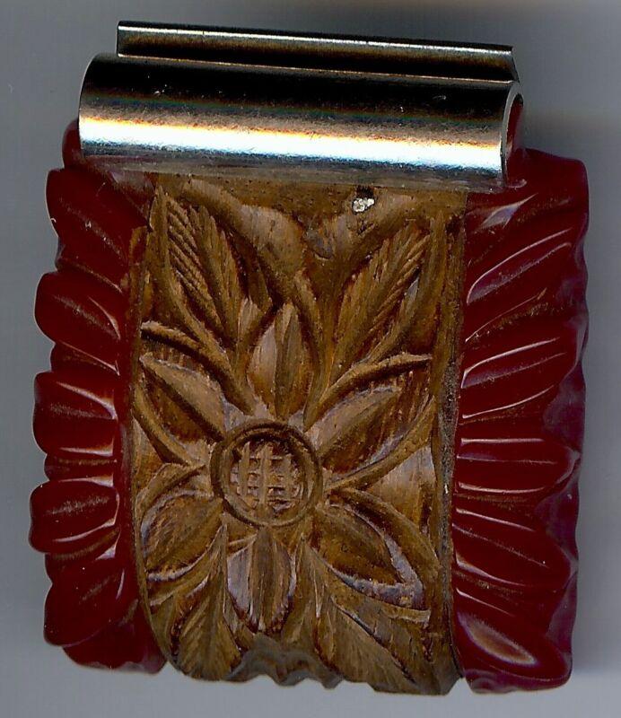 VINTAGE DEEP CARVED RED BAKELITE AND CARVED WOOD FLOWER DRESS CLIP