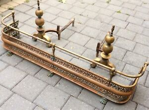 Late 19th century English brass fireplace fender and andirons