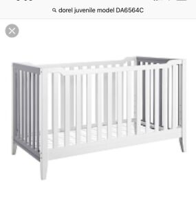 Classic white and subtle grey crib. Great condition.
