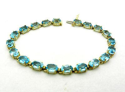 "Beautiful 10k Yellow gold Tennis Blue Topaz Bracelet 7.25"" long 9.0 grams"
