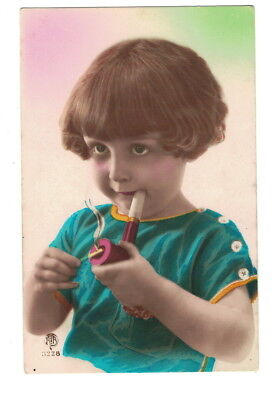 MB8441 NAUGHTY LITTLE  ART DECO GIRL ILLUMINATING HER PIPE, SMOKING TOBACCO RPPC