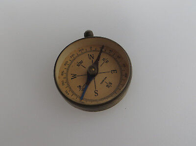 UNTESTED BRASS COLOURED METAL COMPASS MARKED FOREIGN - NO SUSPENSION RING