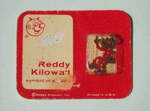 vintage Reddy Kilowatt Charm on Original Card