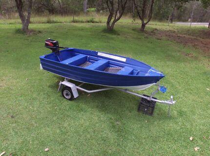 Aluminium boat on registered trailer with motor