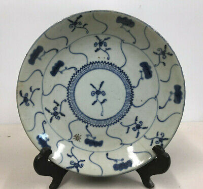 hand thrown plate; Asian signed with text. Porcelain