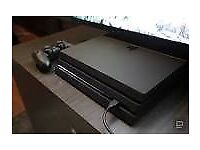 Two PS4's - one working and one for spares or repairs