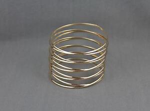 Gold-spiral-bracelet-coil-spring-stacked-style-metal-bangle-cuff-wide-bracelet