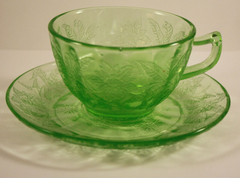 DEPRESSION GLASS FLORAL POINSETTIA GREEN CUP AND SAUCER JEANNETTE GLASS