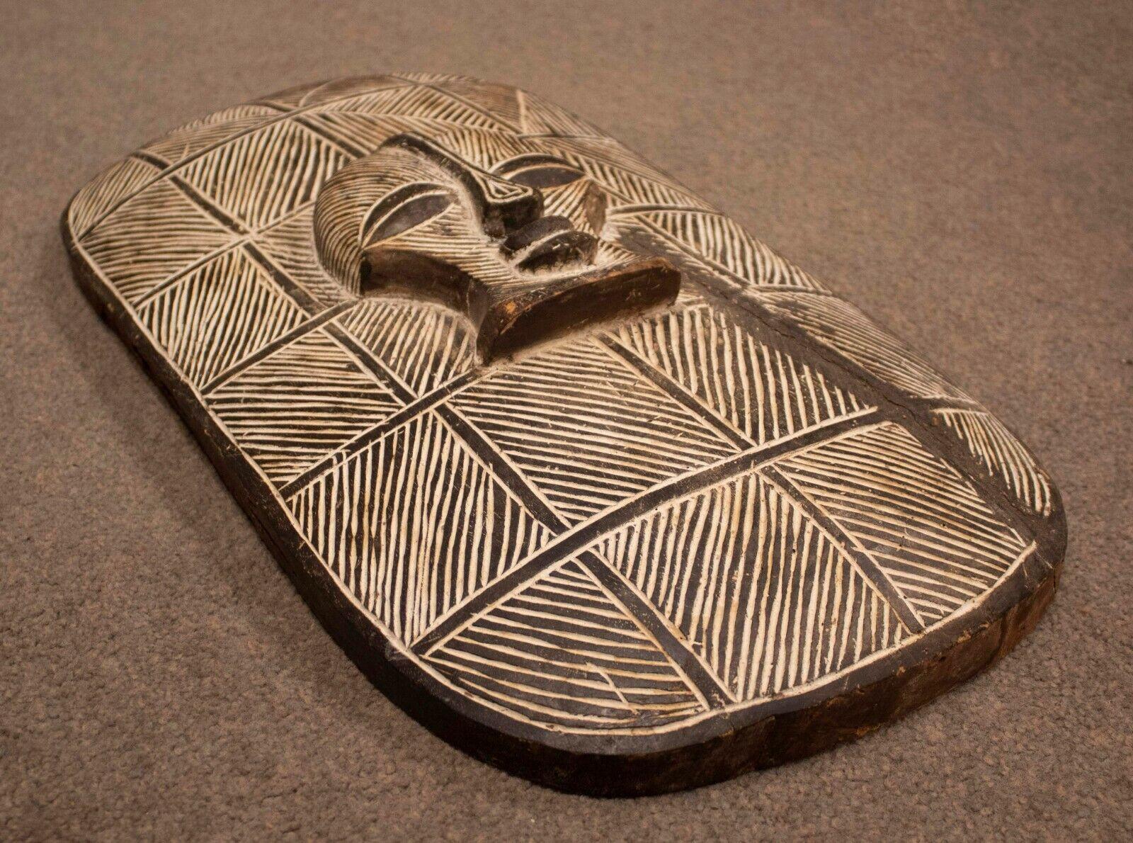 Vintage Large African Relief Carved Shield Mask Sculpture - $300.00