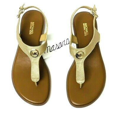 MK Michael Michael Kors Charm Thong Buckle Up Flat Sandal Leather Pale Gold (Michael Kors Charm Flats)