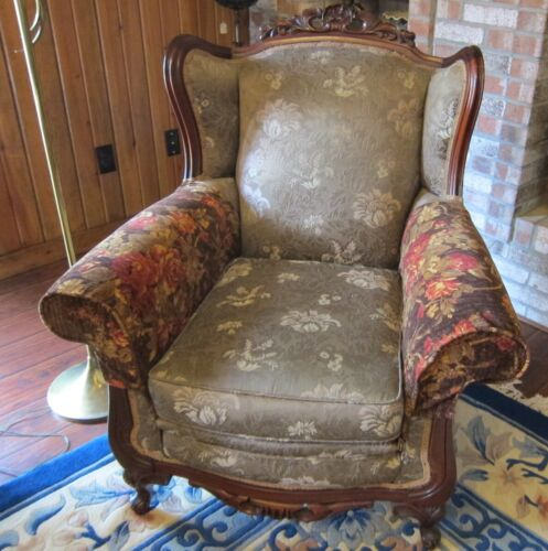 VINTAGE CARVED MAHOGANY WINGBACK ARMCHAIR.