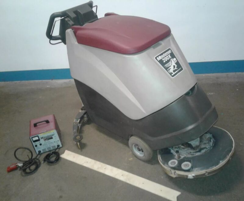 Minuteman 200X Self-Propelled Floor Scrubber with Charger.
