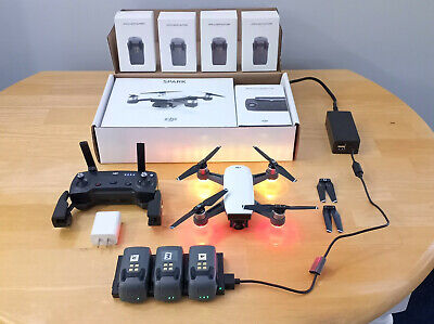 DJI Spark Drone with 4 batteries and charger.